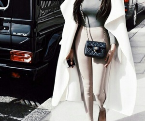 long straight brown hair, black chanel purse, and grey turtleneck image