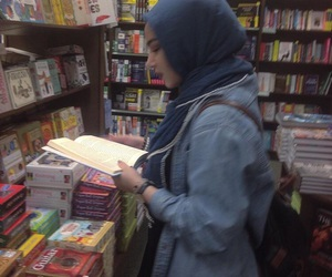 book, hijab, and denim image