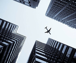 airplane, city, and skyscraper image