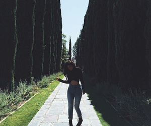 kylie jenner, wavy brown hair, and black ankle booties image