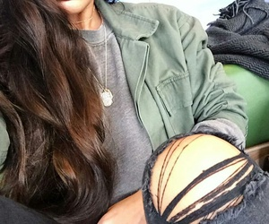 long wavy brown hair, black ripped jeans, and silver necklaces image