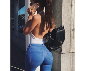 red nails, curvy fashion, and blue skinny jeans image