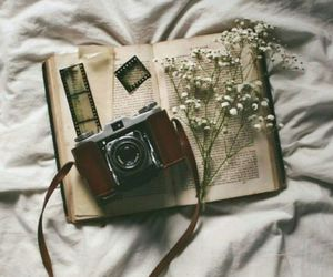 book, flowers, and camera image