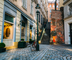 bicycle, cobblestones, and lamppost image