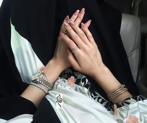 nails and abaya image