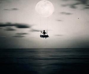 moon, swing, and sea image