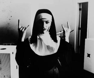 black and white, nun, and rock image