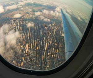 city, plane, and sky image