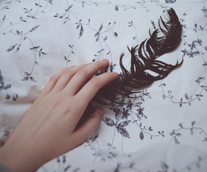hand and feather image