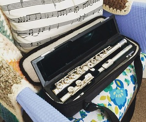 flute, music notes, and pillow image