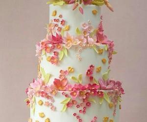 wedding cake and flowers image