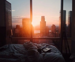 city, sun, and bed image