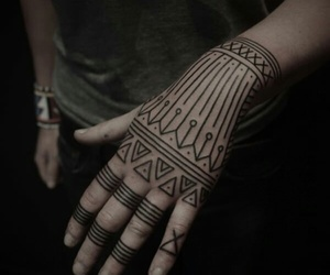 black ink, geometric tattoo, and hand image
