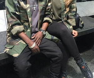 black jeans, black sneakers, and camo jacket image