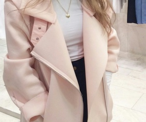 gold necklaces, white turtleneck, and black high waisted jeans image