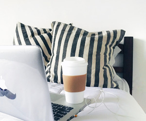 bed, coffee, and laptop image