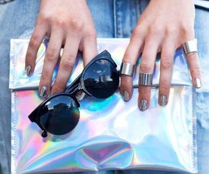 glasses, purse, and holographic image
