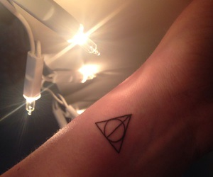 arm, magic, and deathly hallows image
