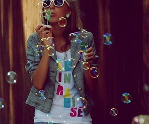 girl and bubbles image