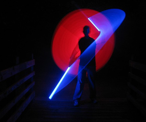 light painting, lightsaber, and long exposure image