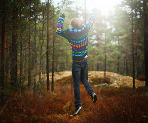 boy, jump, and forest image