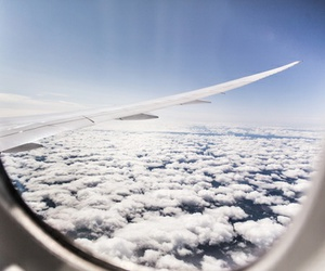 plane, clouds, and sky image