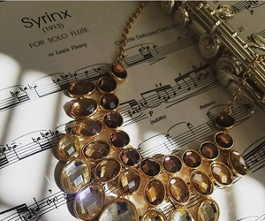 flute, music notes, and necklace image