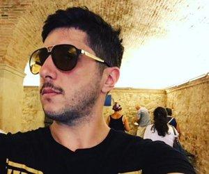 guy and black glasses image