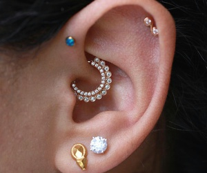 ear, piercing, and clicker image