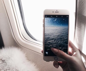 airplane, iphone, and ocean image