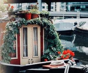 boat, flowers, and river image