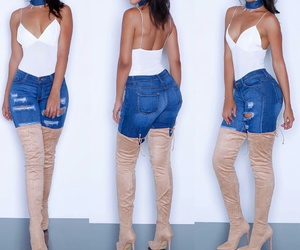 matte lipstick, white bodysuit, and blue ripped jeans image