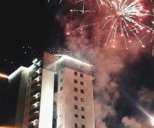 building, fireworks, and people image