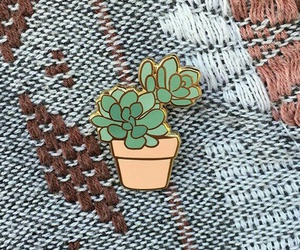 button, pin, and plants image