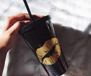 black, gold, and drink image