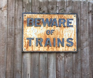 beware, trains, and brown image