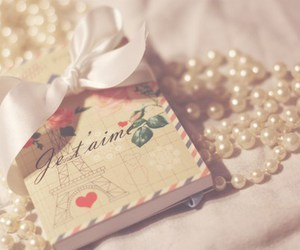 pearls, paris, and book image