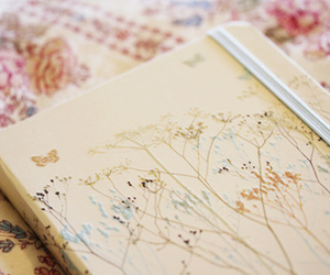 notebook, book, and floral image