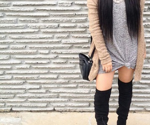 matte lipstick, long straight brown hair, and black thigh high boots image