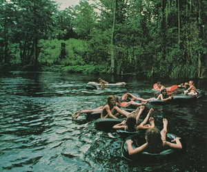 with friends and floating down a river image