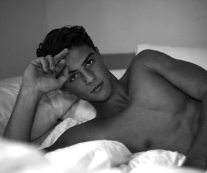 bed, male, and black and white image