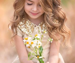 child and flowers image