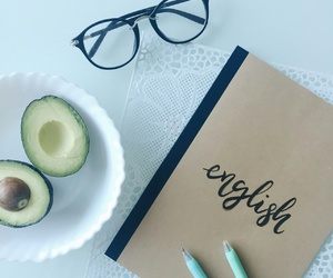 notebook, glasses, and pen image