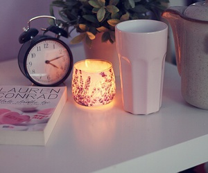 book, candle, and clock image