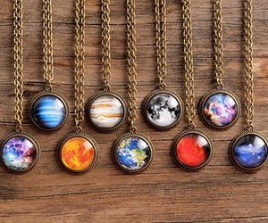 colorful, necklace, and planets image