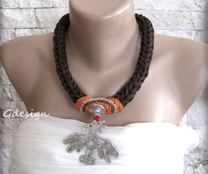 brown, crochet, and statement jewellery image