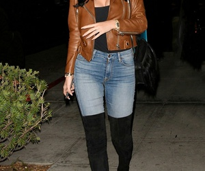 kylie jenner, gold watches, and blue skinny jeans image