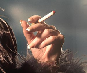 nails and cigarette image