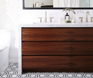 light fixtures, tiled floor, and wood cabinet image