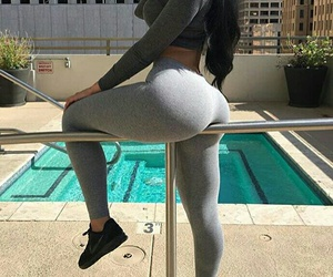 black sneakers, grey leggings, and curvy fashion image